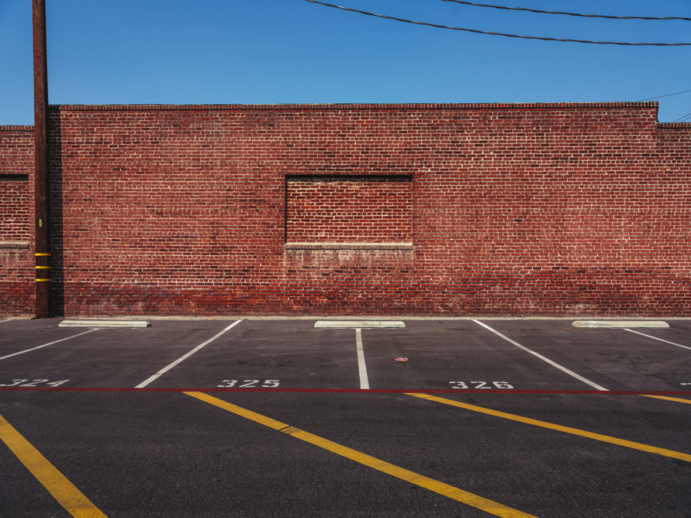 Minimal urban landscape photograph of architecture with a brick wall