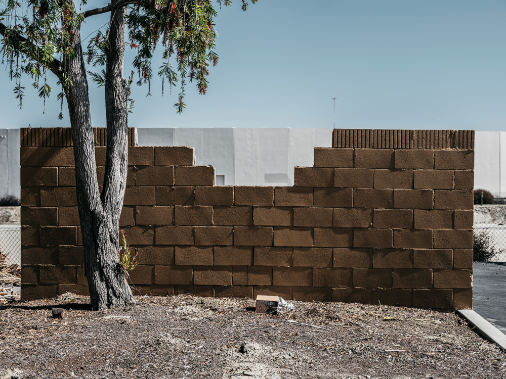 Minimal urban landscape photograph of architecture with a weird wall