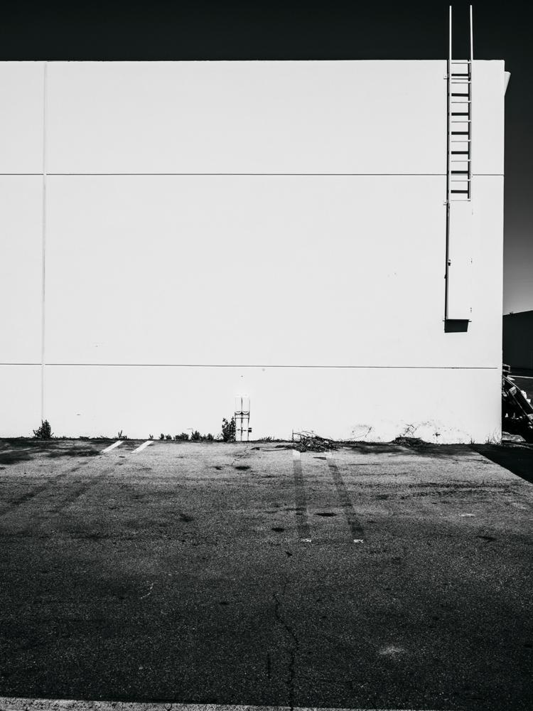 Minimal urban landscape photograph of architecture in black and white with a dramatic feel