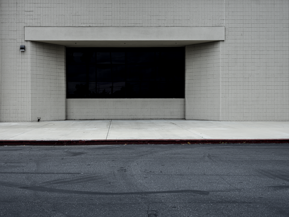 Minimal urban landscape photograph of architecture with a black window space