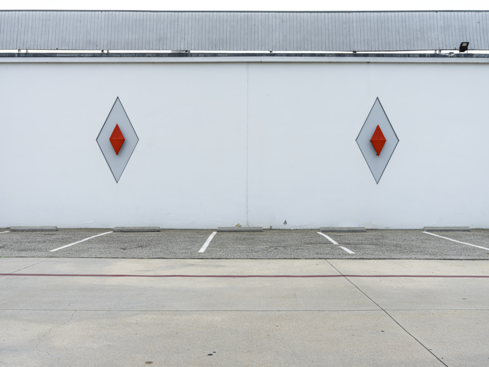 Minimal urban landscape photograph of architecture with 2 diamond shapes perfectly balanced