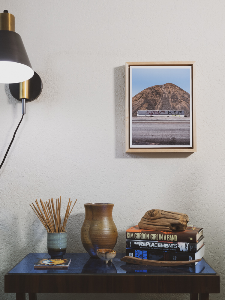 A Curtis Stage framed photograph in a room